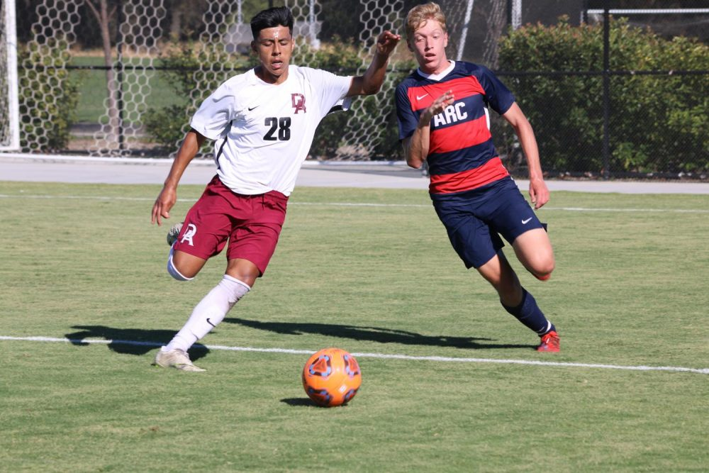 De Anza College forward Douglas Stone defends the ball against American River College forward Kyle Prusia during a match at ARC home soccer stadium on Sept. 06, 2019.(Photo by Emily Mello)