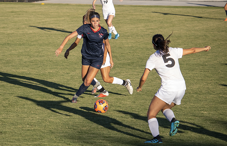 Forward Ashley Davis evades a defender in a game against Fresno City College on Sept. 6, 2019. American River College lost the match 4-0. (Photo by Colin Bartley)