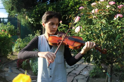 Lida Haphar, biochem and molecular biology major, has been playing the violin since she was 6-years-old and in the last year she has competed in the Crescendo International Music Competition at Carnegie Hall in New York City. (Photo by Emily Mello)