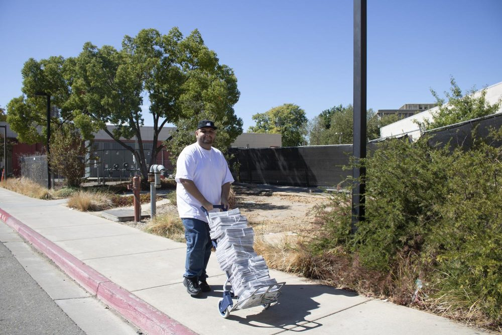 Current's staff writer Brandon Zamora walks to distribute newspapers near the Athletics Department at American River College on Sept. 25, 2019. (Photo by Alexis Warren)