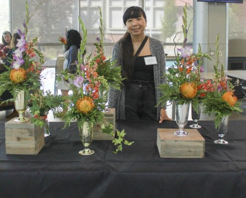 Floriculture student Southida Venethongkham sells flowers in the Student Center at American River College on Sept. 19, 2019. (Photo by Marquala Brown)