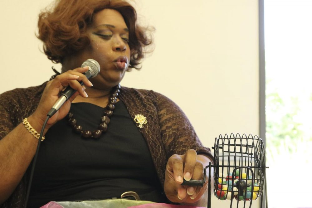 Drag Queen, Madam Sass C. turns the wheel of the bingo cage during the Drag Bingo event at American River College on Sept. 3, 2019. (photo by Ariel Caspar)