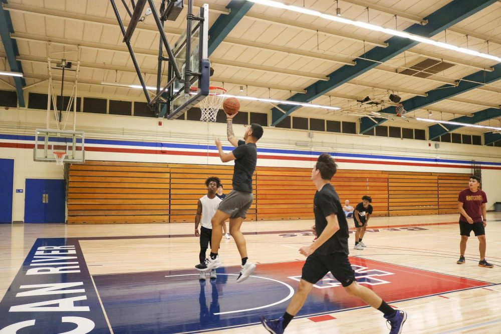 History major Javier Garcia shoots a lay-up during Team Activities class in the gym at American River College on Sept. 26 , 2019. (Photo by Emily Mello)