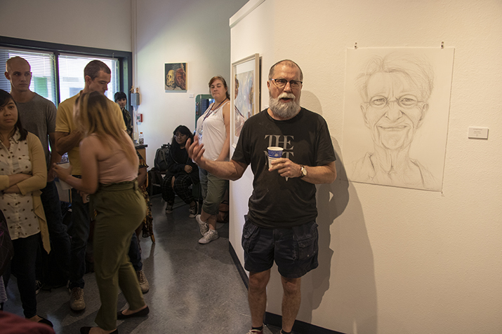 Craig Smith speaks about his artwork at the reception for the fall faculty art show at the James Kaneko Art Gallery American River College on Sept. 4, 2019. (Photo by Colin Bartley)