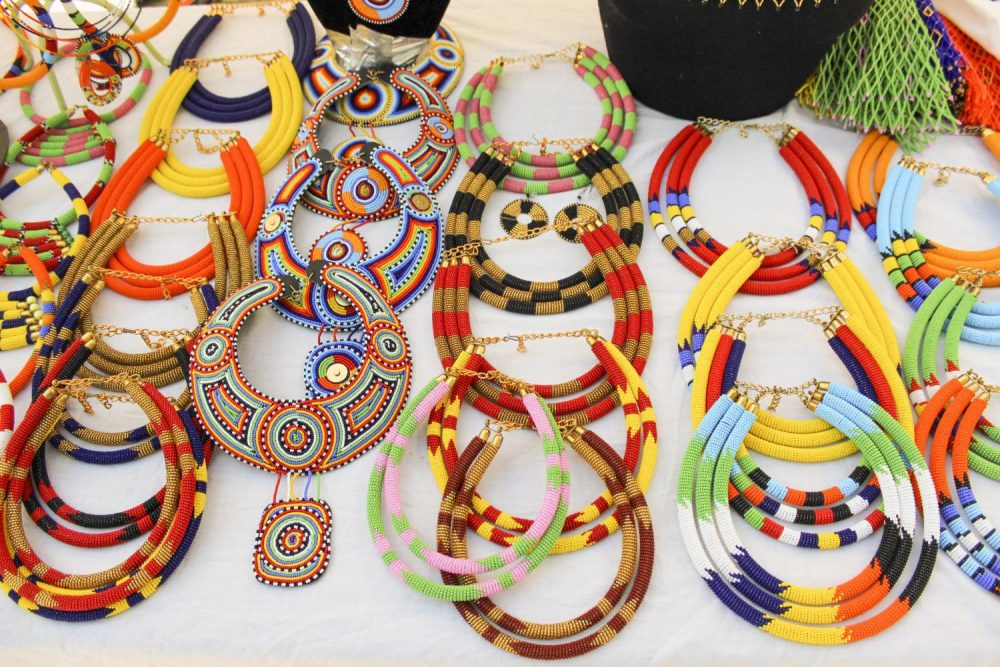 Colorful+necklaces+imported+from+Africa+lay+on+a+vendor+table+during+the+Department+Days+event+part+of+the+Weeks+of+Welcome+Extravaganza+at+American+River+College+on+Sept.+12%2C+2019.+%28Photo+by+Oden+Taylor%29%0A