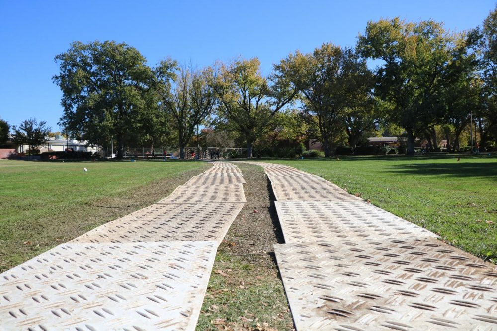 A makeshift path cutting through the grass in front of the campus is being used to get vehicles on and off the construction site on Oct. 29, 2019. (Photo by Jack Harris)