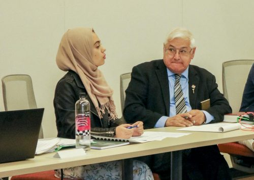 President Aesha Abduljabbar (left) addresses the Student Senate meeting agenda with Parliamentarian Lorenzo Cuesta (right) at American River College on Oct. 4 , 2019.