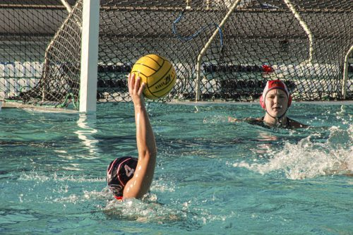 Elizabeth Fomine no. 4 is taking a shot against the San Joaquin Mustangs at the American River College pool on Oct. 9, 2019. (Photo by Bram Martinez)