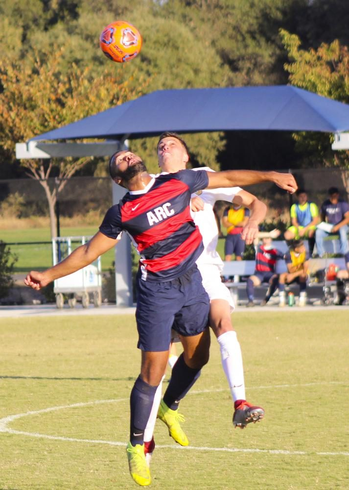 Forward Jonas Babel-Buckner fights for the ball in a game against Butte College on Oct. 18, 2019 at American River College. ARC lost the game 2-0. (Photo by Josh Ghiorso)