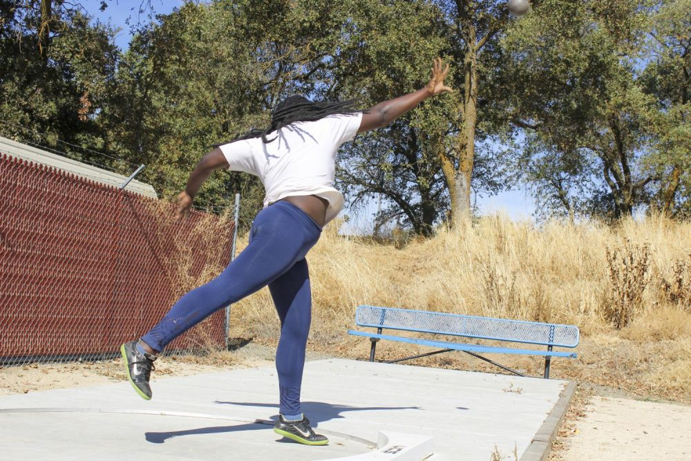 Psychology major Amarachukwu Ohia practices shot put in her track and field class at American River College on Oct. 22, 2019.