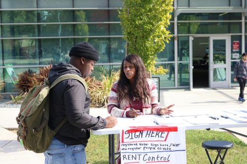 Undecided major Jonny Williams registers to vote at booth in front of the Student Center at American River College on Oct.16, 2019 (Photo by Josh Ghiorso)