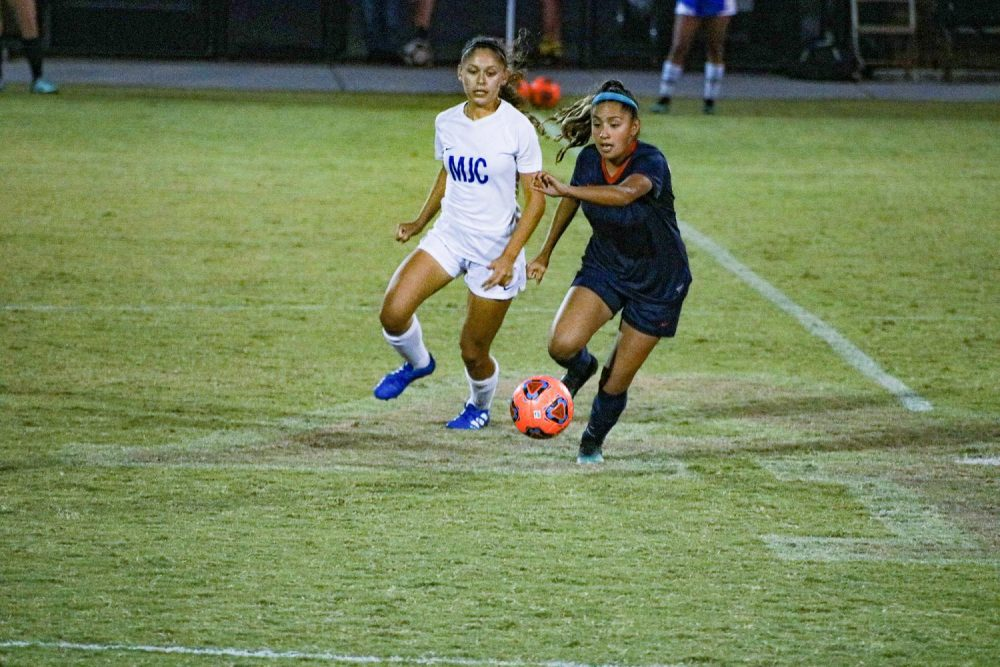 Midfielder Kelly Ortega dribbles the ball downfield in a win against Modesto City College on Oct. 15, 2019 at American River College (Photo by Bram Martinez).