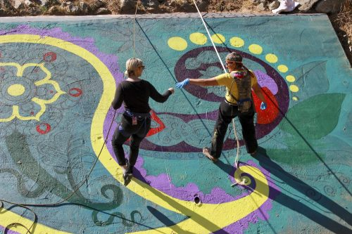 Jade Jacobs and Renee Marie painting a new bridge mural at American River College on Oct. 15, 2019. (Photo by Colin Bartley)