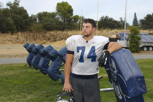 James Ghilardi leans on a tackle sled on the American River College football field after practice on Oct. 16 2019. (Photo by Colin Bartley)
