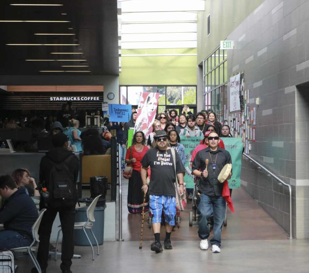 Members and friends of the Native American community celebrate Indigenous Peoples Day, a response to Columbus Day in the Student Center at American River College on Oct. 14, 2019 (Photo by Jack Harris)