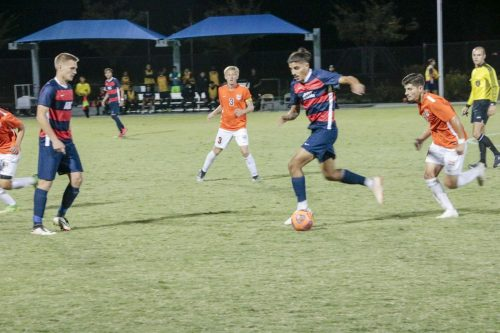 American River College defender Noel Hernandez passes through the Cosumnes River College defense , during a game at ARC on Sept. 27 , 2019. ARC won the game 2-0 (Photo by Josh Ghiorso)