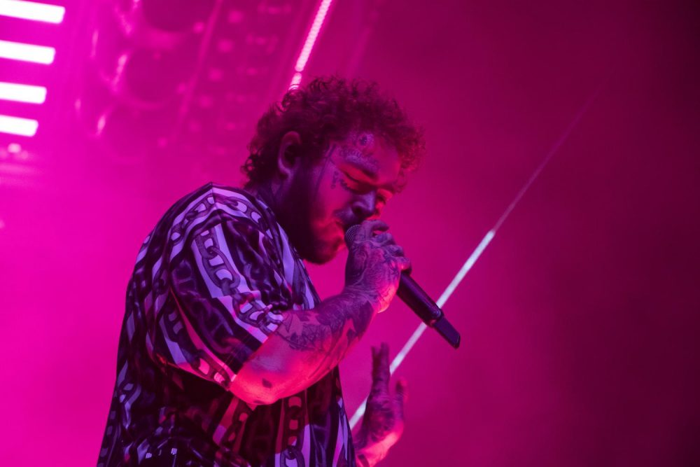 Rapper+Post+Malone+performs+at+the+Golden+1+Center+during+his+Runaway+Tour+in+Sacramento%2C+California+on+Sept.+19%2C+2019.+The+tour+coincides+with+his+wildly+successful+latest+album%2C+%E2%80%9CHollywood%E2%80%99s+Bleeding%2C%E2%80%9D+which+marks+a+departure+from+his+earlier+music.+%28Photo+by+Ashley+Hayes-Stone%29