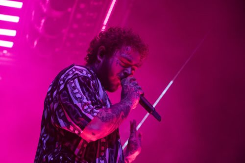 "Rapper Post Malone performs at the Golden 1 Center during his Runaway Tour in Sacramento, California on Sept. 19, 2019. The tour coincides with his wildly successful latest album, ""Hollywood's Bleeding,"" which marks a departure from his earlier music. (Photo by Ashley Hayes-Stone)"