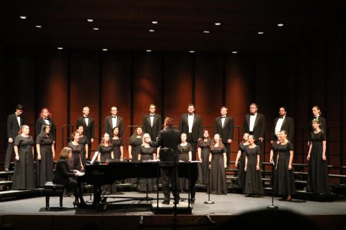 Ralph Hughes conducts the American River College Concert Choir with Heidi Van Regenmorter accompanying for fall the Choral Invitational Concert at the ARC Main theatre on Nov. 5, 2019. (Photo by Bram Martinez)