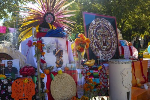Latinos Unidos club set up a Dia De Los Muertos shrine which honors the dead, in front of the Student Center at American River College on Nov. 5, 2019 (Photo by Colin Bartley)