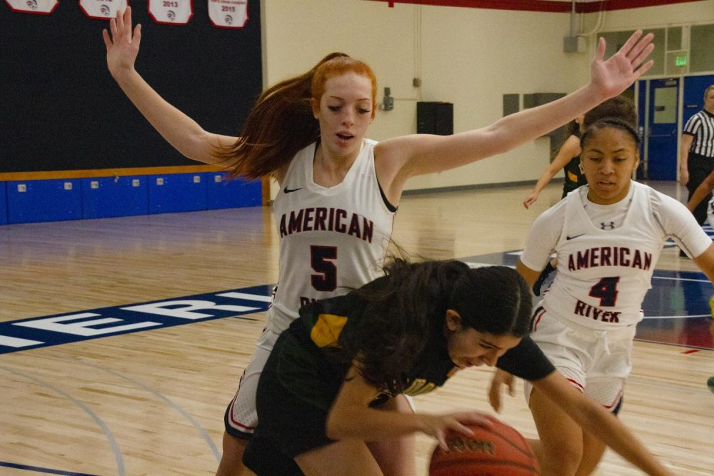 American River college starter Kaitlyn Janese (left) blocks a Napa Valley player in their first game of the season at ARC on Nov. 14, 2019. ARC won the opener 89 - 4. (Photo by Jennah Booth)