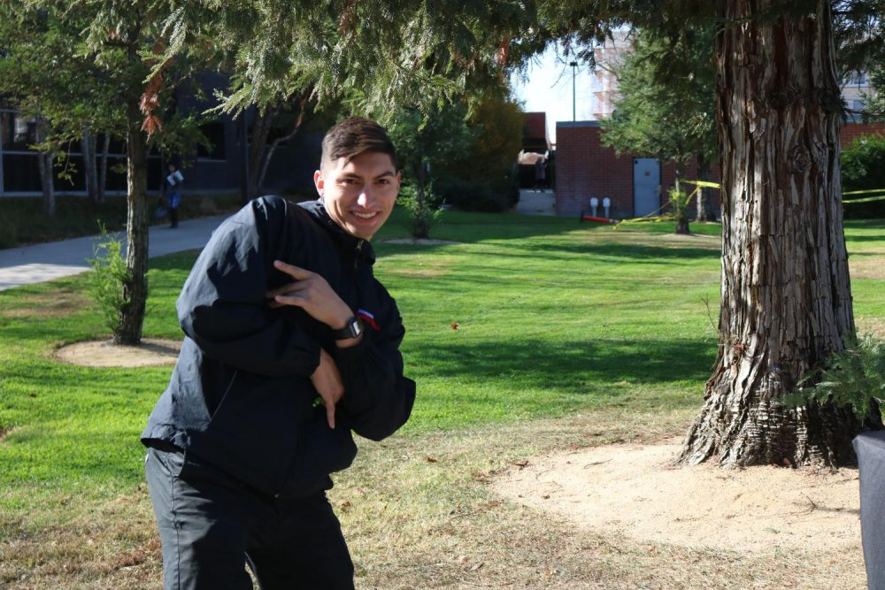 Business administration major and California Family Fitness recruiter Kain Gurrola poses for a picture while taking a break from his booth next to the Learning Resource Center at American River College on Nov 25, 2019. (Photo By Marquala Brown)