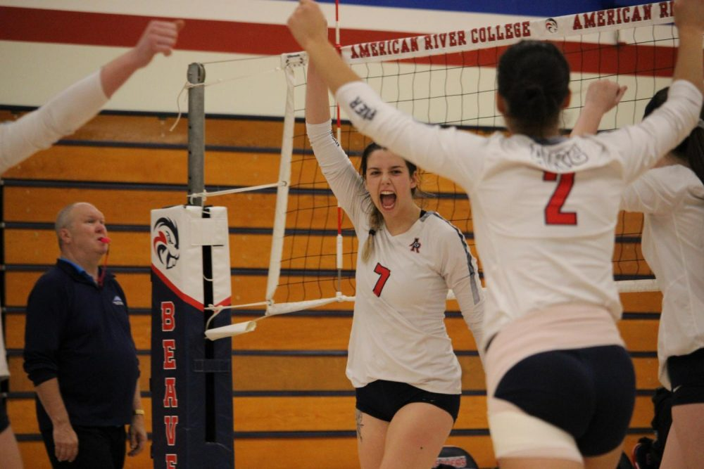 American River College volleyball player Allison Linder celebrates with her teammates during the first round of the CCCAA Norcal Regional Championships in a home match versus Solano Community College. ARC won the match 3-1. (Photo by Emily Mello)