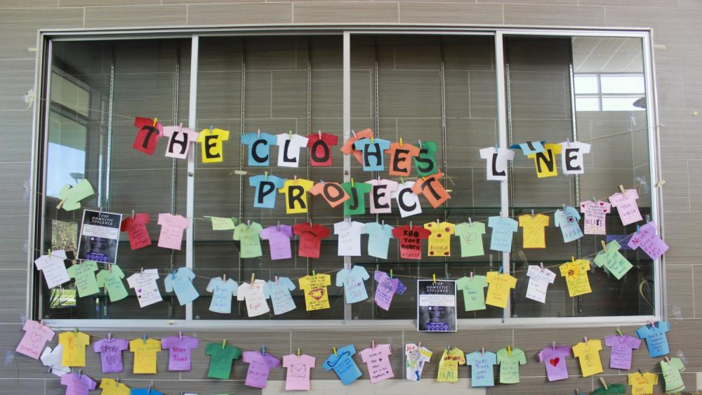 In an attempt to tackle domestic violence and highlight their resources to students, WEAVE'S Clothesline Project hangs in the Student Center at American River College on Nov. 7, 2019. (Photo by Ariel Caspar)