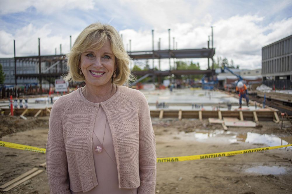 American River College alumna Diane Bryant stands before the framework of the Diane Bryant STEM Innovation Center, to which she donated a half-million dollars, and which is named in her honor. (Photo courtesy of Luis Gael Jimenez)