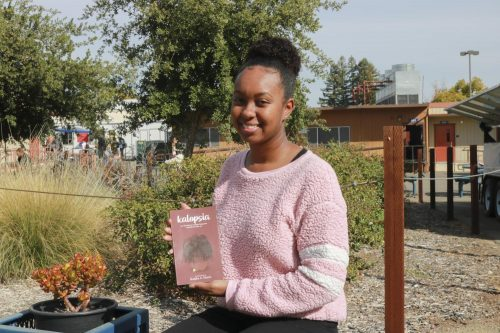 Writer Kanika Harris, pictured here at American River College on Nov. 12, 2019, with her new book of poetry.