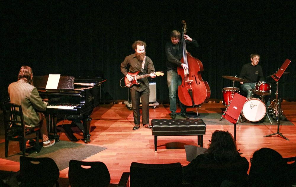 (Left to right: Kevin Hamby, Andrew Little, Ryan Woempner, Michael Warner) Andrew Little who played Jazz guitar for his Applied Music Recital with assitance from his bandmates at the Fine Arts Building at American River College on Dec. 2, 2019. (Photo by Bram Martinez)