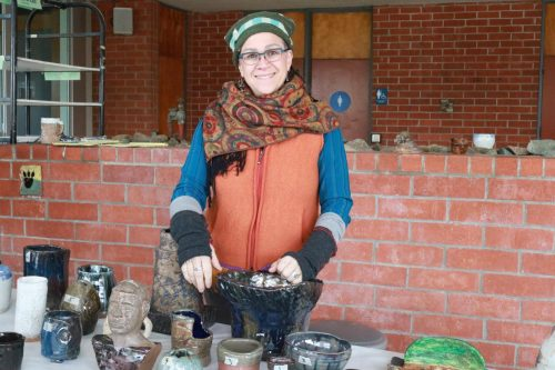 Ceramics Professor Linda Gelfman runs the pottery sale on Dec 11, 2019. (Photo by Marquala Brown)
