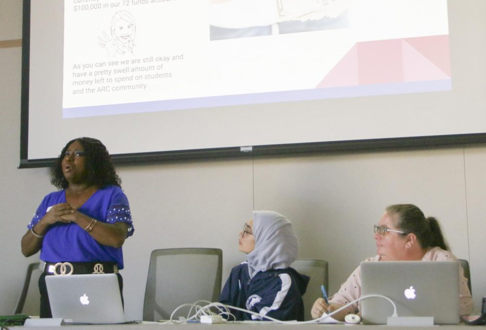 Director of Finance Sha Toyia Anderson (left) presented the Finance Report for the Associated Student Body's fall 2019 semester to the rest of the ASB Student Senate on Dec. 6, 2019. (Photo by Jack Harris)