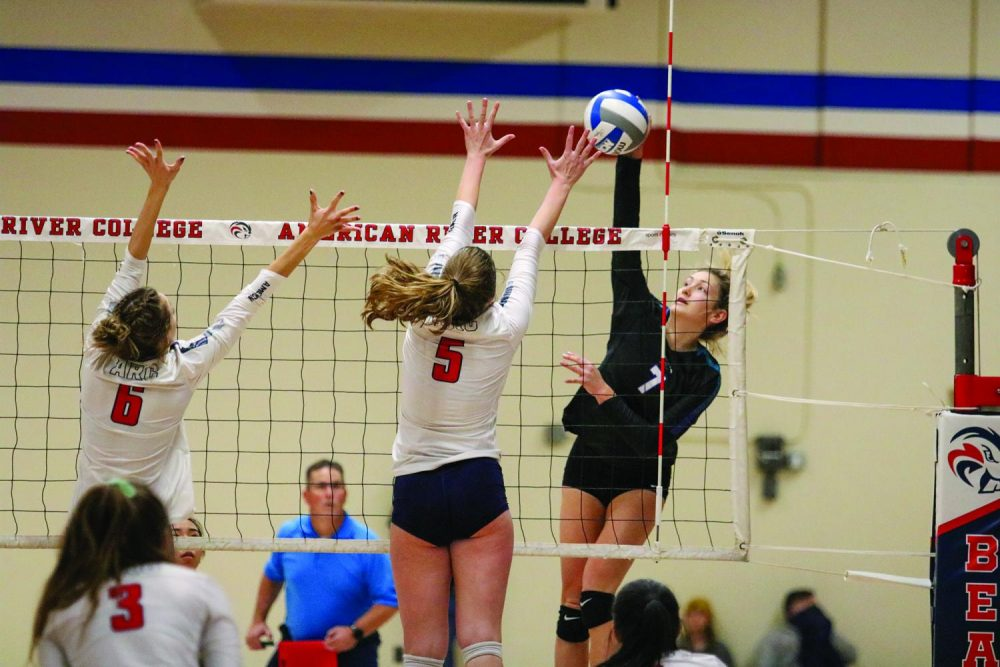 Zoe Zimmerman, freshman outside hitter, blocks the ball during a game against Folsom Lake College that earn the team a spot in the California Community College Athletic Association's 2019 Women