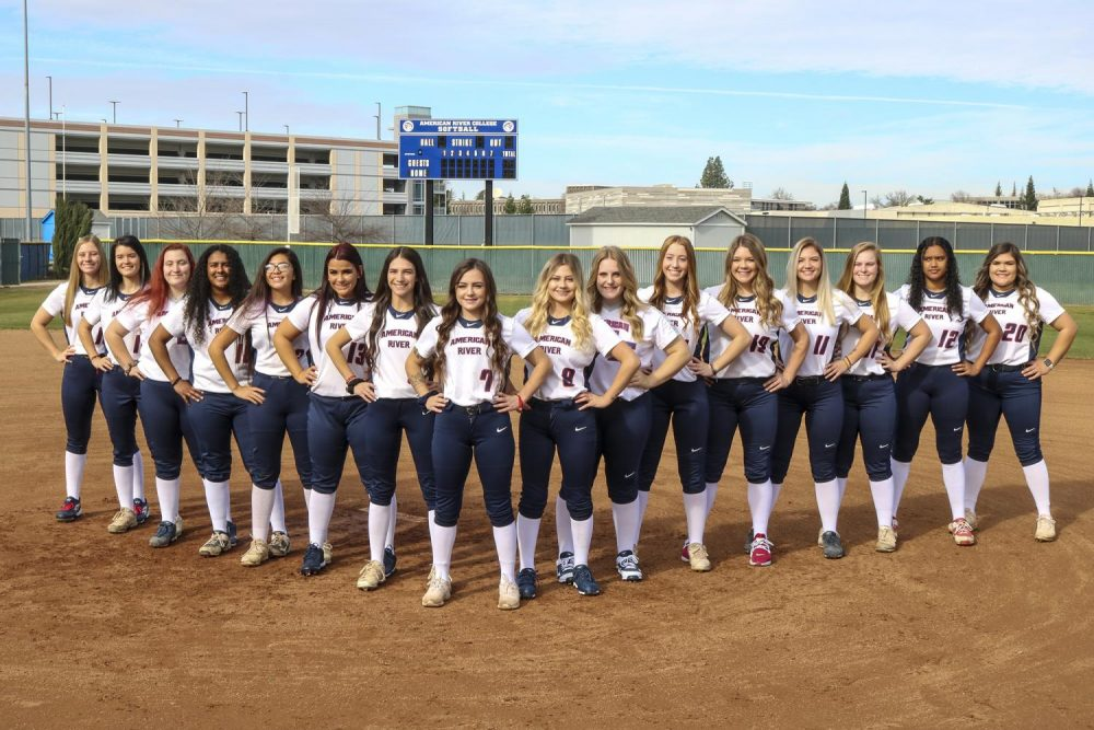 American River College's softball team lines up on the ARC softball field on Jan. 24, 2020 for their team photo, standing ready for the upcoming season as one united team. (Photo by Brandon Zamora)