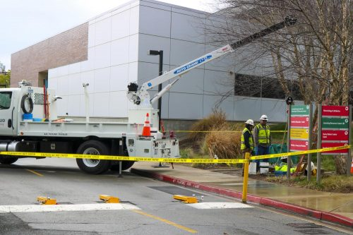 SMUD repair trucks close off the road by the American River College main gymnasium on Jan. 28, 2020. (Photo by Colin Bartley)