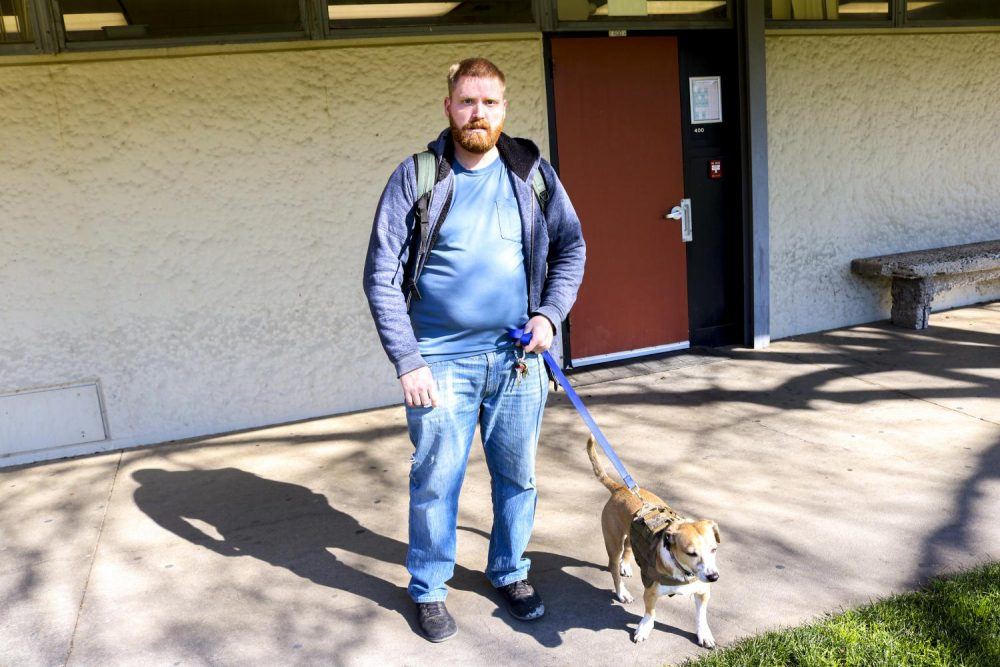 Jared Miller, a Social Work major, walking his service dog Houdini through the American River College Campus on Feb. 5.  (Photo by Bram Martinez)