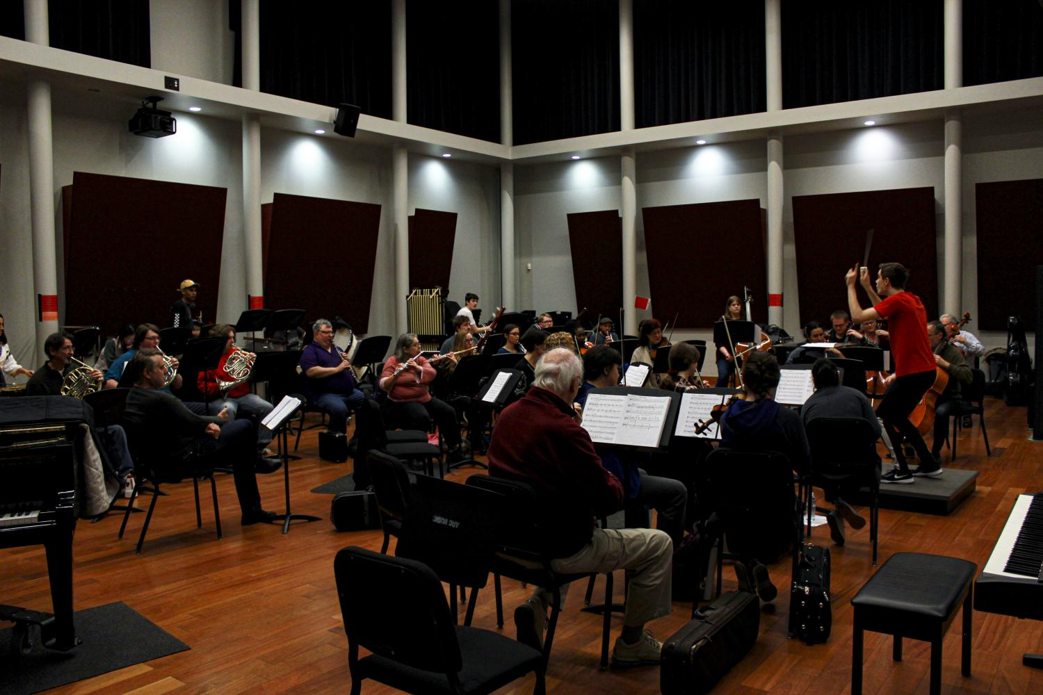Composer Colin Regan conducts the orchestra practice for the Aria Concert, in the band room at American River College Main Theatre, every Wednesday at 7 p.m - 9:30 p.m. (Photo by Bram Martinez).