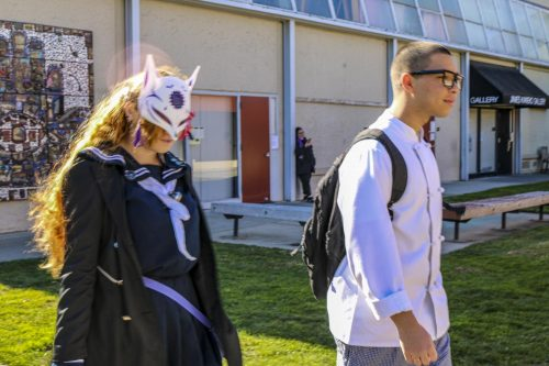 Culinary arts major,  Zavier Silva Carranza and his sister, Aniya Silva, wearing cosplay, walking to the Oak Cafe on Feb 3, 2020. (Photo by Colin Bartley)