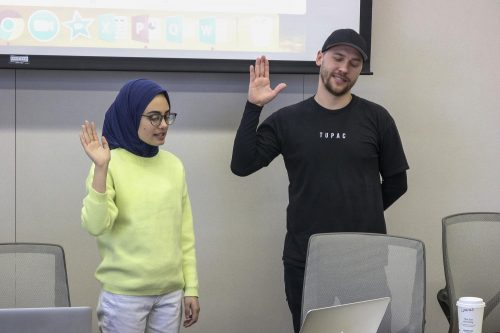 American River College Associated Student Body president Aesha Abduljabbar swears in newest senate member, Ross Kolesnikov at a Student Senate meeting on Feb. 7, 2020. (Photo by Brandon Zamora)