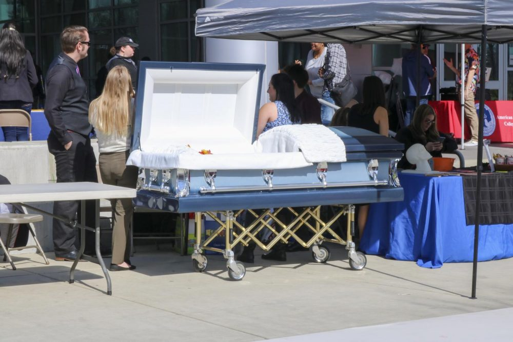 The Funeral Service Education program displays a coffin outside of the Student Center at American River College on Feb. 20, 2020.  (Photo by Heather Amberson)