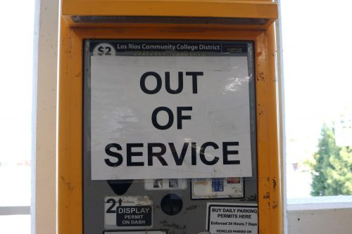 "A parking meter on the fourth floor of the parking garage at American River College displays an ""out of service"" sign during the spring semester. (Photo by Emily Mello)"