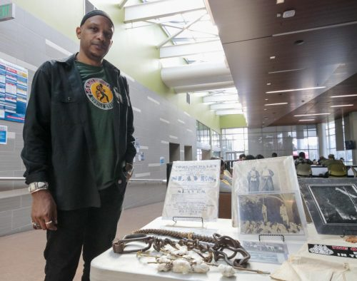 Khalid El - Hakim is the founder and curator of the Black History 101 mobile museum. He has been traveling all over the U.S and exposed the artifacts at the Student Center at American River College on Feb.13 , 2020. (Photo by Emily Mello)