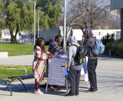 Petitioners gathering students signature outside of the student center at American River College campus on Jan. 30, 2020.(Photo by Clifton Bullock)