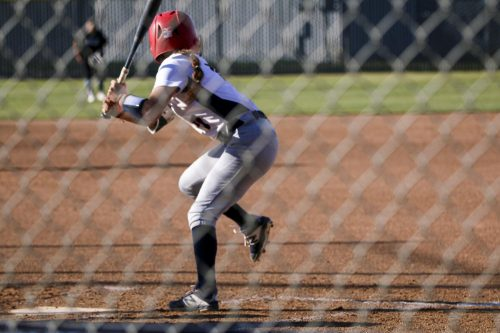 Ciera Pyle about to hit, which leads her to a full run against the Folsom Lake Falcons on Feb. 25 at the softball stadium at American River College.  (Photo by Bram Martinez)