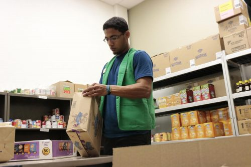 Pictured here is Muhammad Alam, kinesiology major, as he helps unpack food at American River College food pantry on March 13, 2020, just days before the campus shutdown. Since then, the Beaver Food Pantry has continued to work remotely. (Photo by Emily Mello)