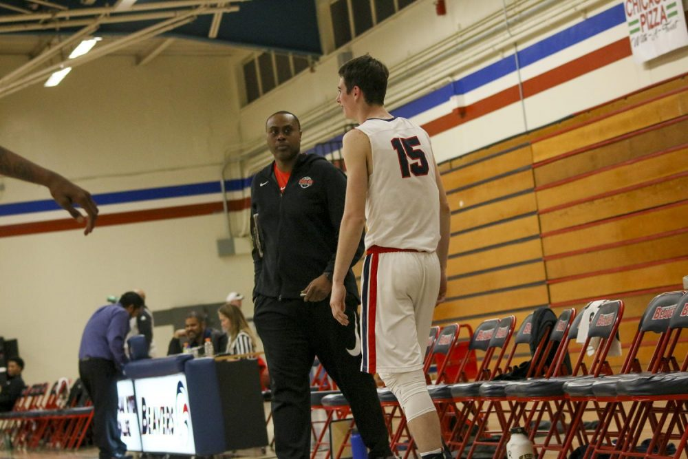 ARC men's basketball assistant coach Kenny Thomas talks to ARC forward David O'Looney during the game against San Joaquin Delta on Feb. 11.  (Photo by Heather Amberson)