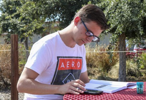 Physics major,  Jonathan Macdonald sits outside at a table in the Portable Village, studying on March 9, 2020 at American River College. (Photo by Brandon Zamora)