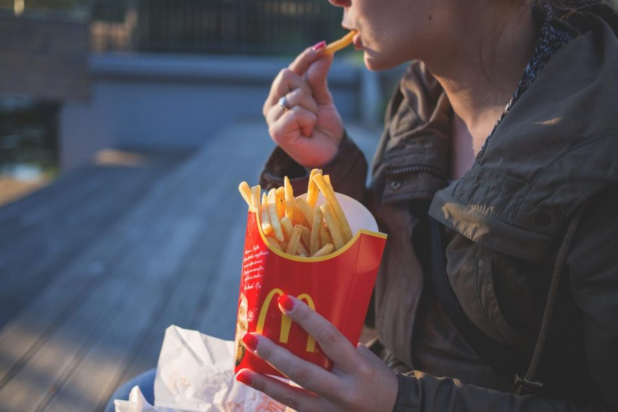 Fast food companies that are choosing to keep drive-thrus open during the COVID-19 pandemic are putting their employees and the public at risk to contract this contagious virus. (Photo courtesy of freestocks.org)