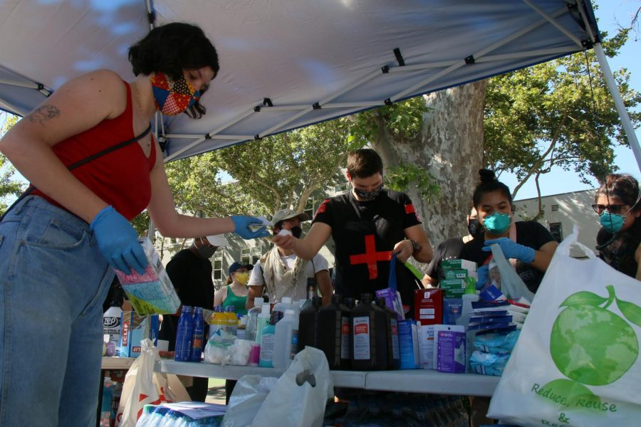 The Sacramento LGBT Community Center and the Gender Health Center stationed themselves in the Center's parking lot on 20th and J Street in downtown Sacramento to provide medical supplies for protesters, on June 2, 2020. Volunteers assembled care kits that contained medical supplies, snacks, and water to be distributed for the demonstrators while they marched against police brutality. (Photo by Emily Mello)